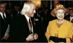 Thomas-Bartlett-#ABP-Americans-Bombing-Paris-Writer-Jimmy Saville with the Queen of England