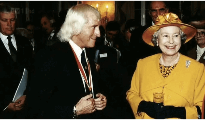 Jimmy Saville with the Queen of England